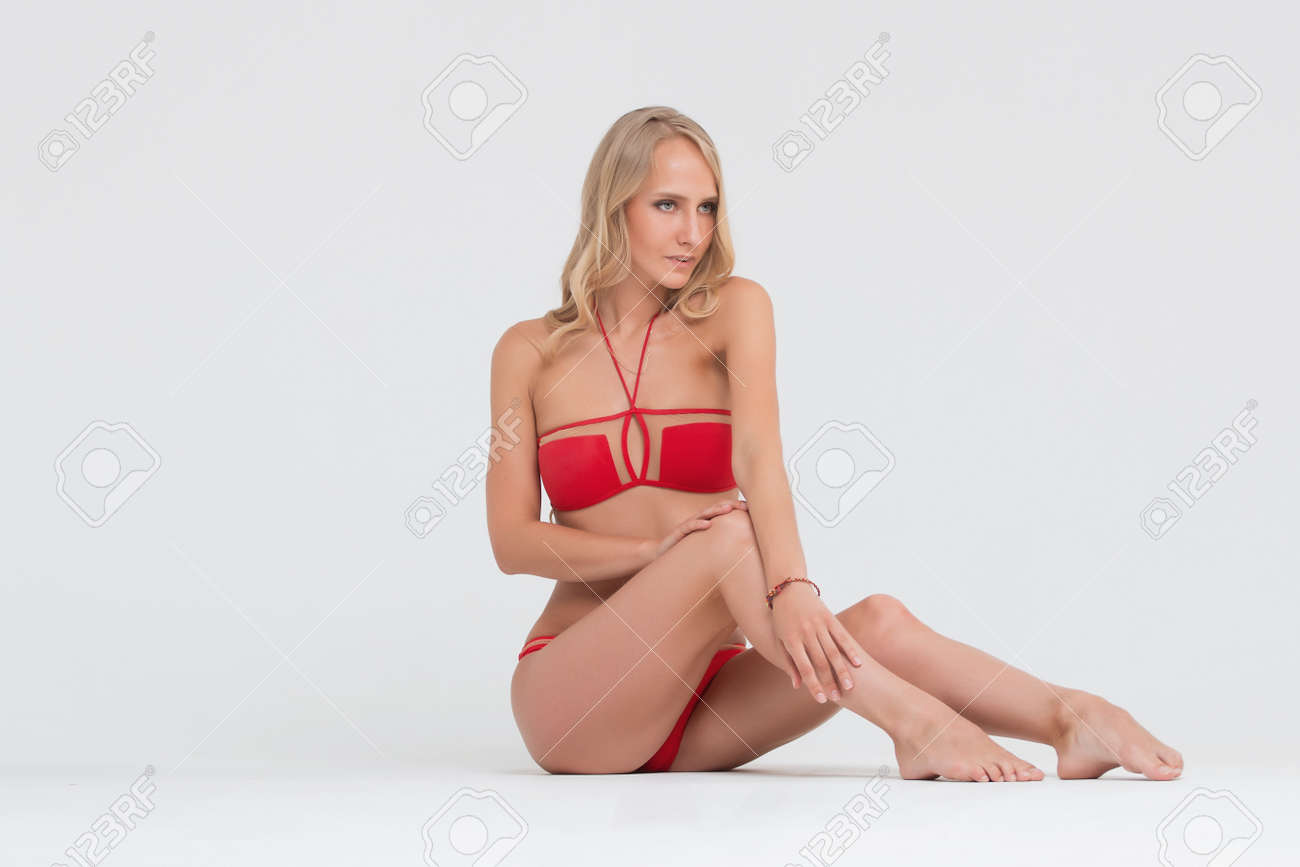2b3c54f1f2 Girl with perfect body in red underwear on white background. Stock Photo -  74145371