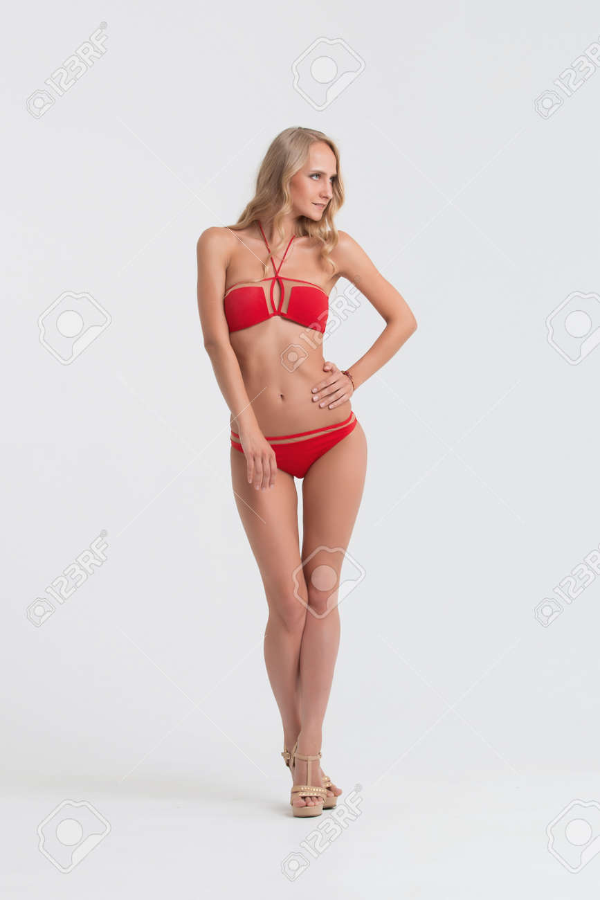bcbb9936b0 Girl with perfect body in red underwear on white background. Stock Photo -  74303468