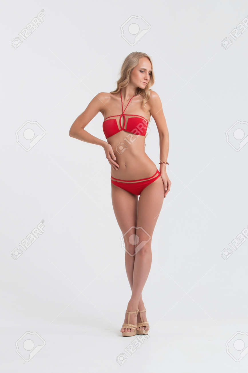 e1004f9dad Girl with perfect body in red underwear on white background. Stock Photo -  74303473
