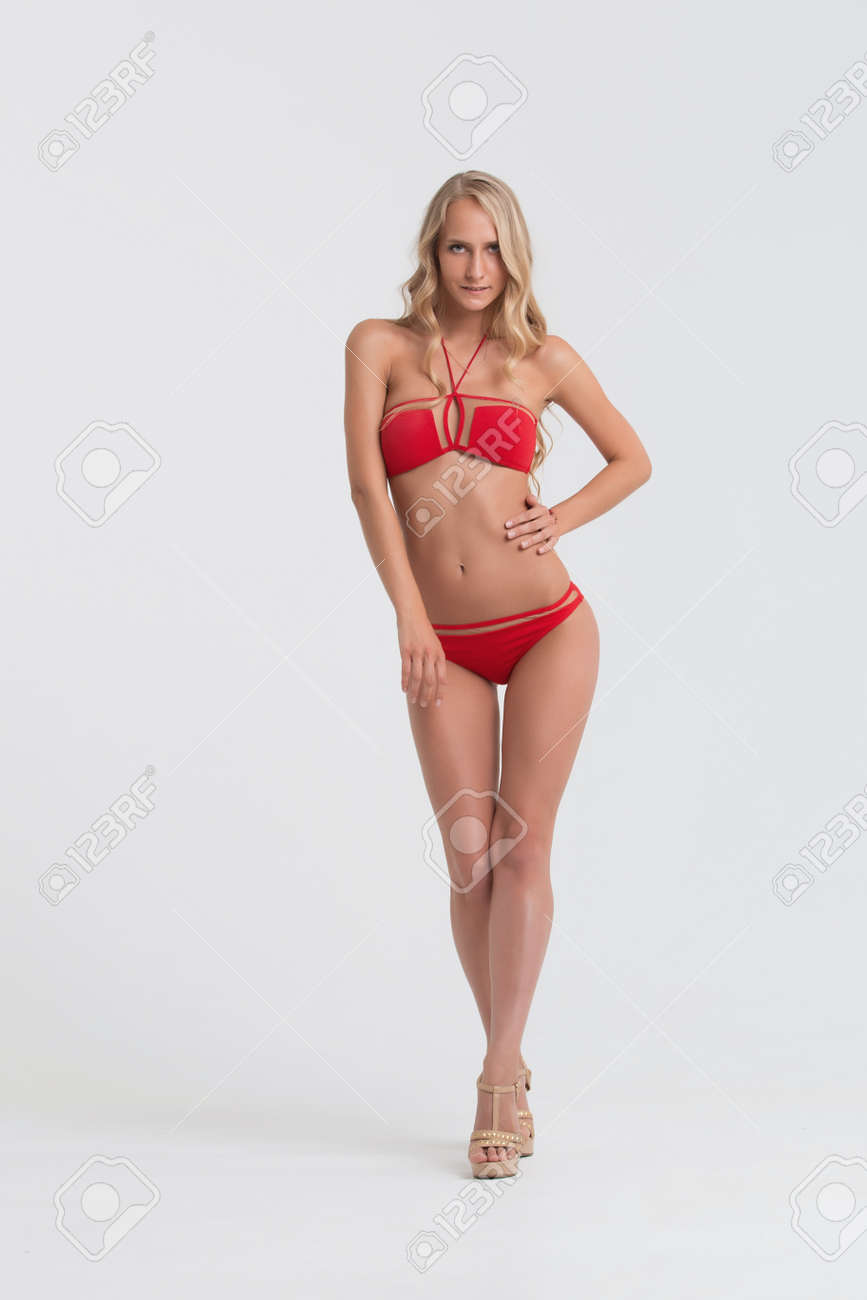 40762b4016 Girl with perfect body in red underwear on white background. Stock Photo -  74398027