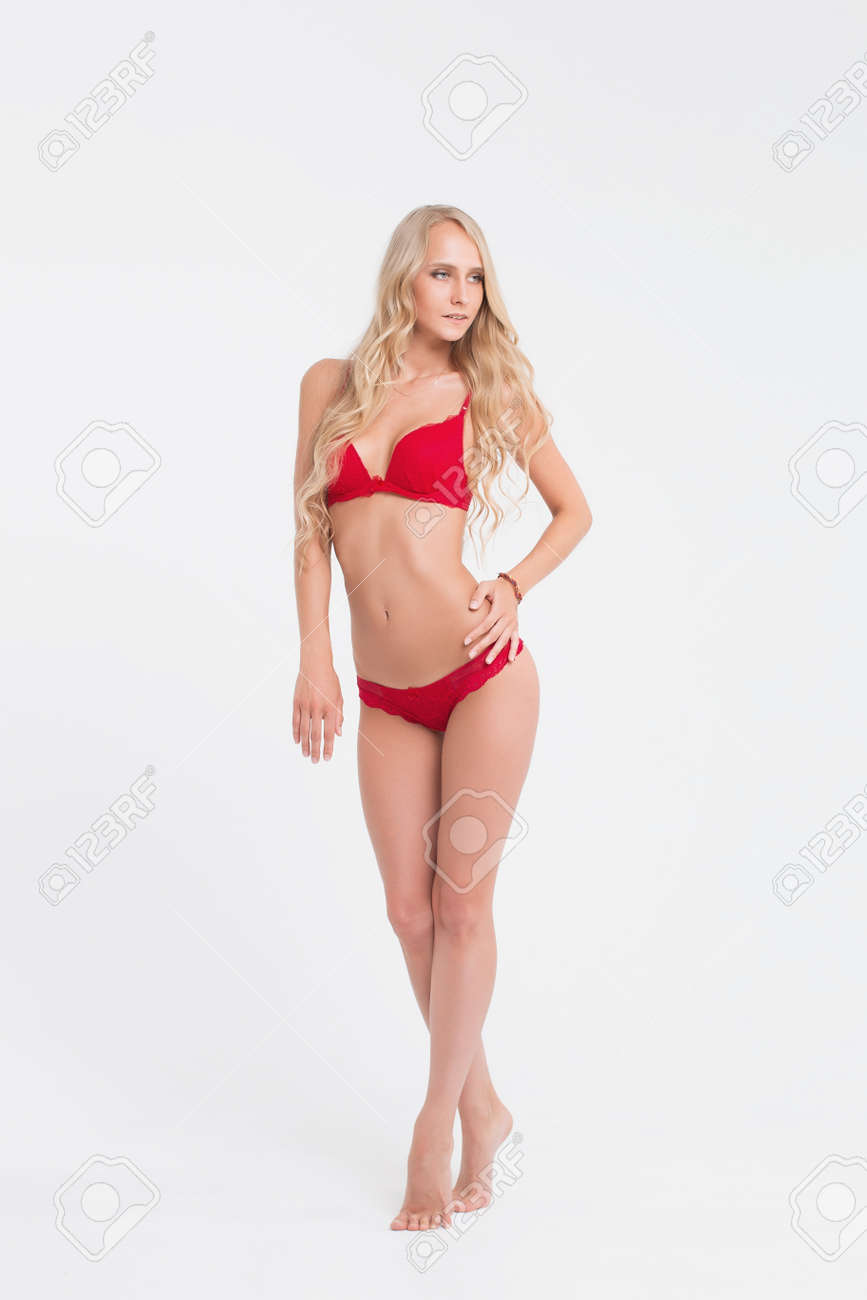 c3b7636d1d Girl with perfect body in red underwear on white background Stock Photo -  76608242