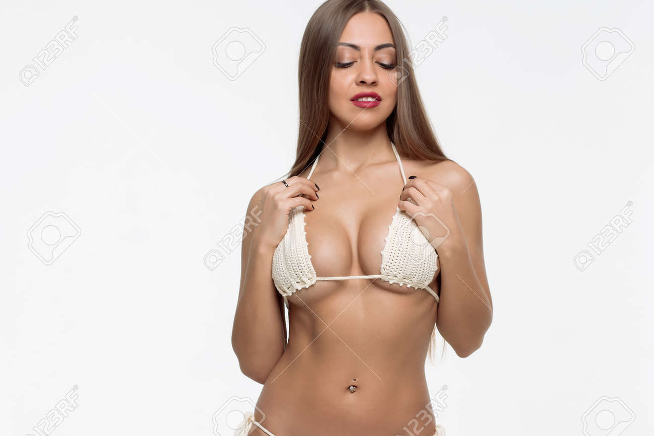Stock Photo - Young beautiful girl shows her gorgeous Breasts