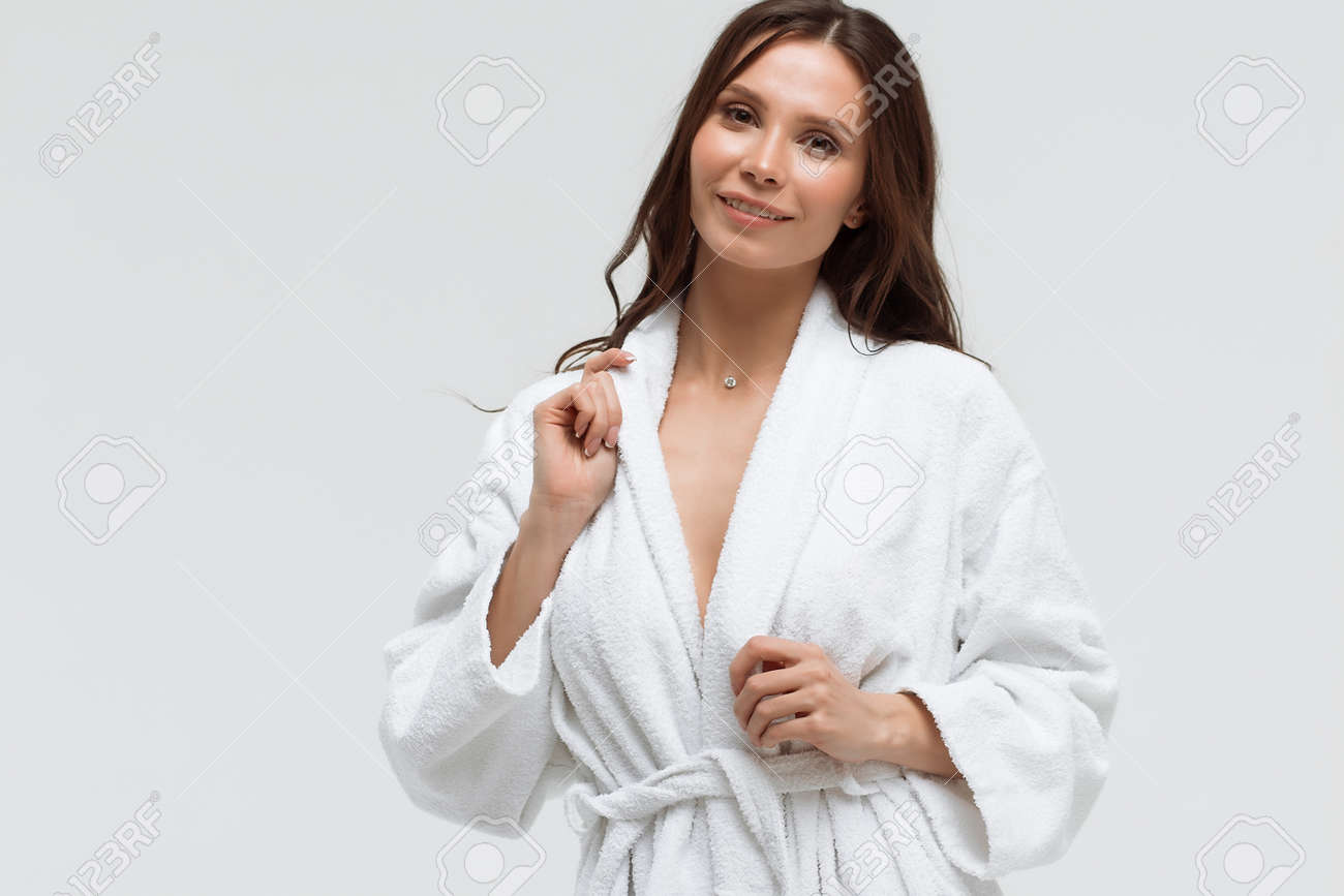 Long Haired Sensual Woman In Fluffy White Bathrobe And Looking Stock Photo Picture And Royalty Free Image Image 140102030