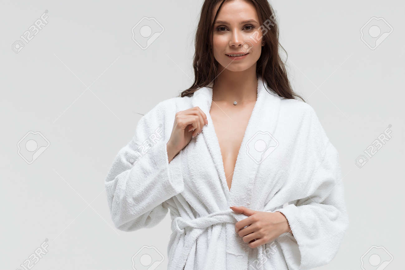 Long Haired Sensual Woman In Fluffy White Bathrobe And Looking Stock Photo Picture And Royalty Free Image Image 140102033