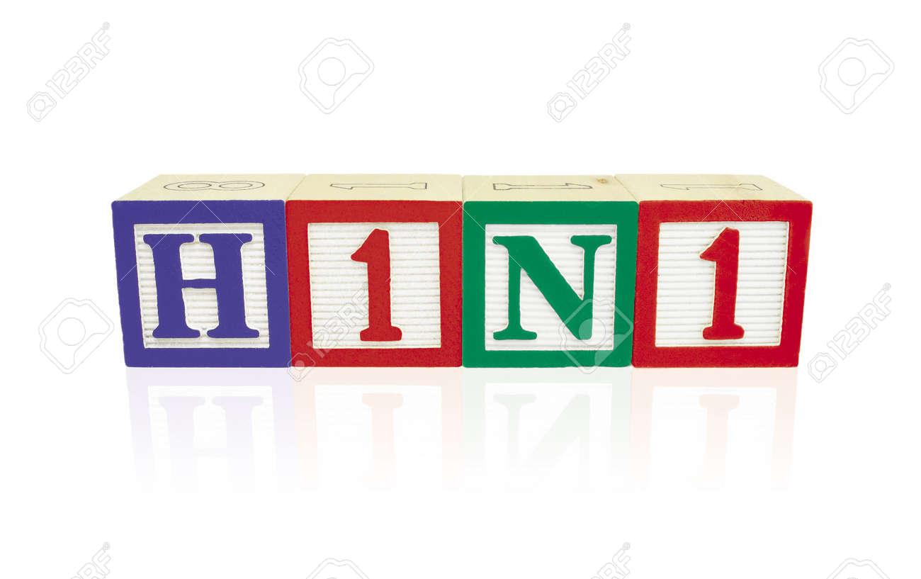 Alphabet blocks arranged horizontally on a reflective white surface to spell 'H1N1' Stock Photo - 6053532
