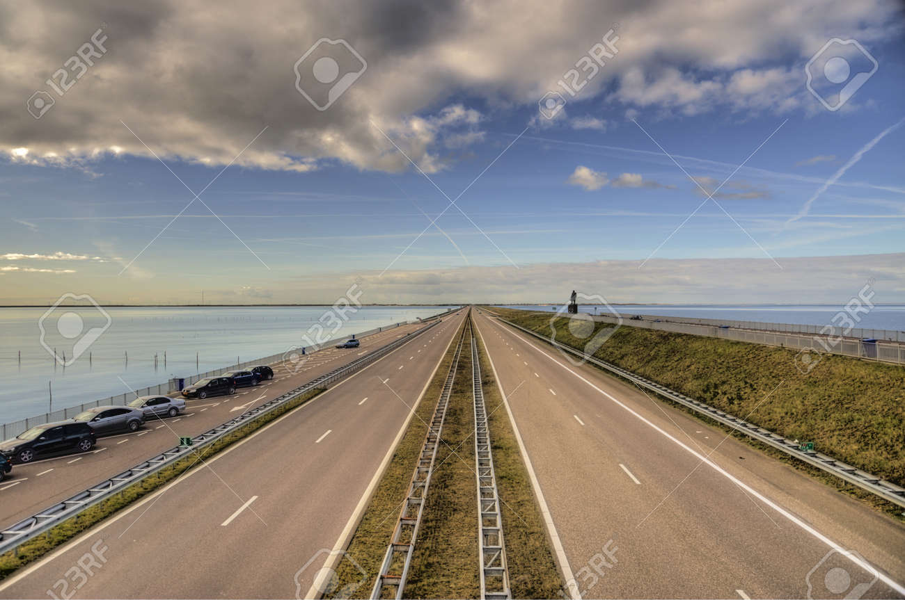 street at the ijssel lake in the netherlands with cloudy sky (hdr) - 8457714