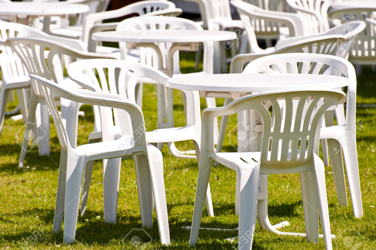 White Plastic Garden Chairs on Grass Stock Photo   25780124. White Plastic Garden Chairs On Grass Stock Photo  Picture And