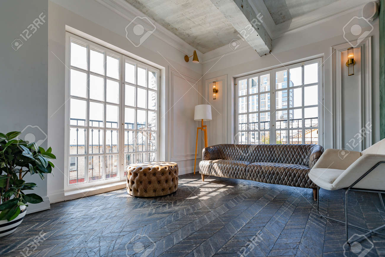 Chic, luxurious guest room design with old-fashioned antique furniture. white walls are decorated with relief. there is a beautiful dark brown parquet on the floor. - 156720833