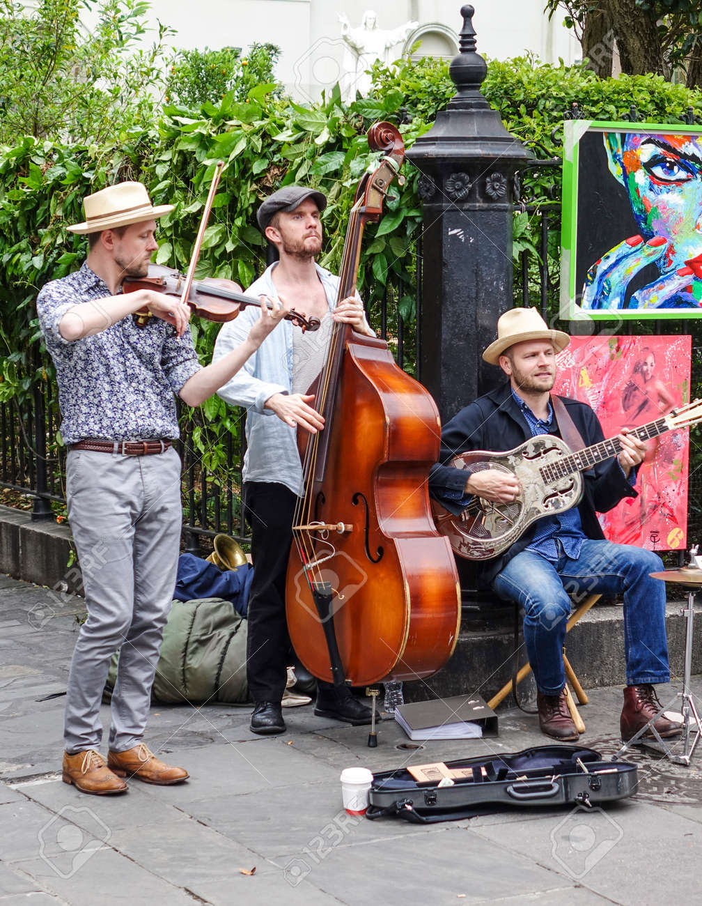 Typical street musicians for jazz music in New Orleans - NEW ORLEANS, LOUSIANA - APRIL 17, 2016 - 56094337