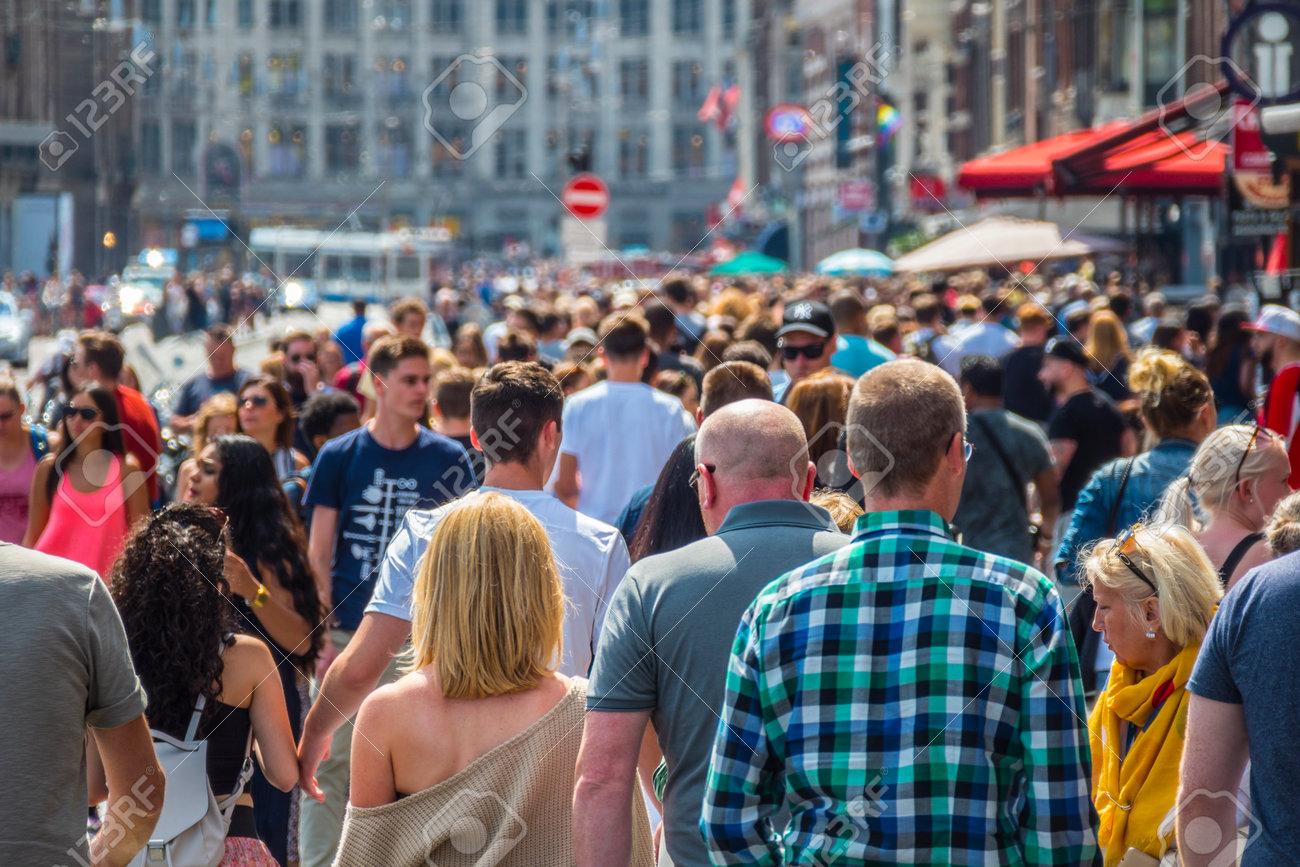 Huge crowd of people at Damrak Street in Amsterdam - 85148910