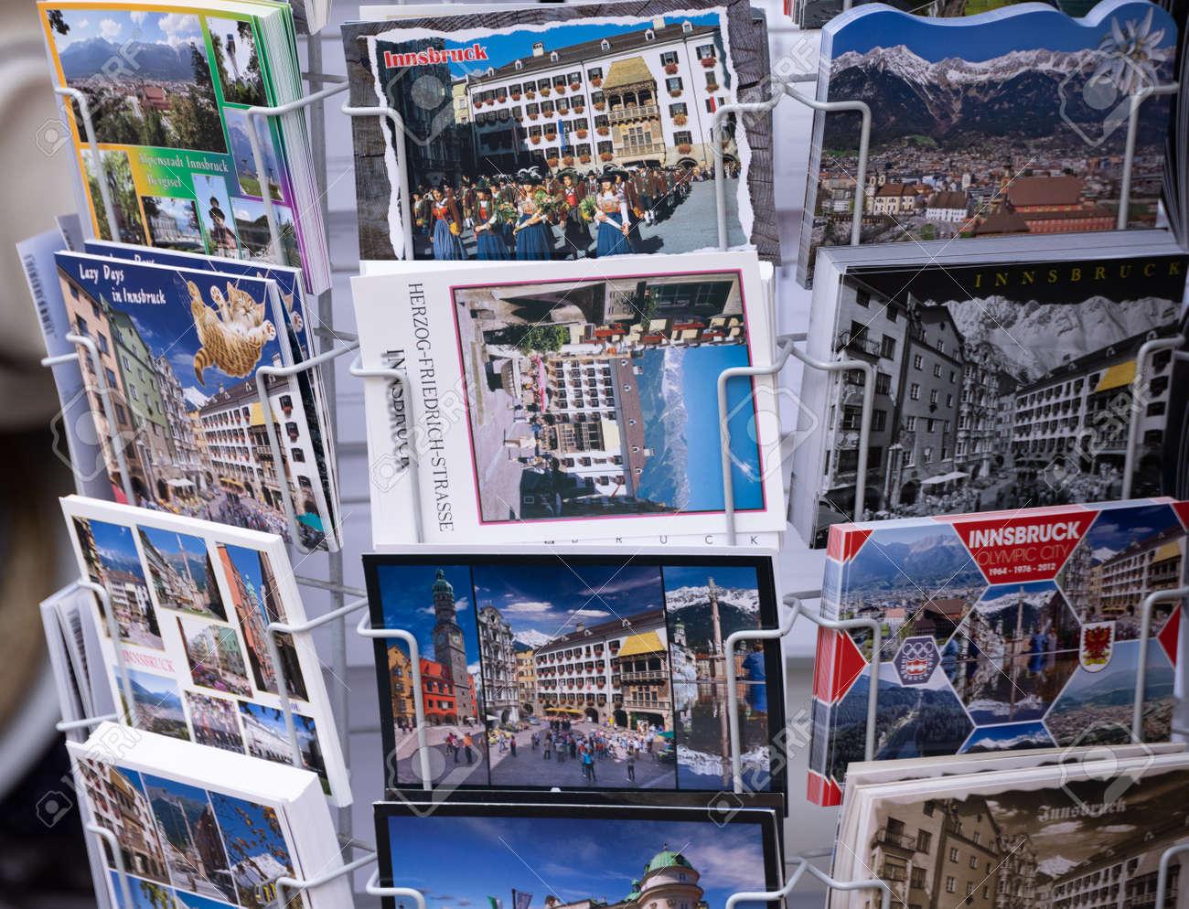 Postcards from Innsbruck AUSTRIA, EUROPE - souvenir shop - INNSBRUCK, AUSTRIA, EUROPE - JULY 29, 2021 - 173492632