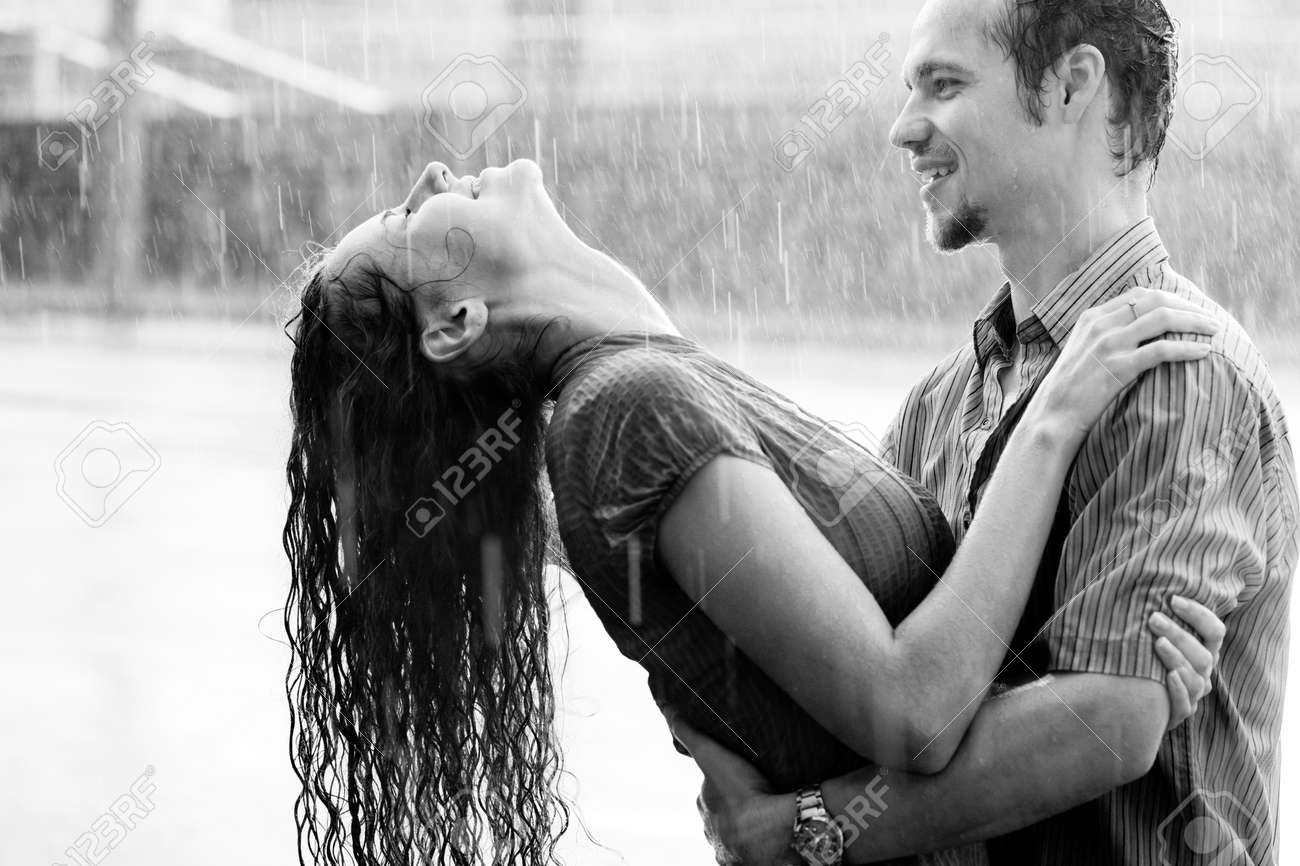 Love In The Rain Boy And A Girl Kissing And Hugging In The Warm
