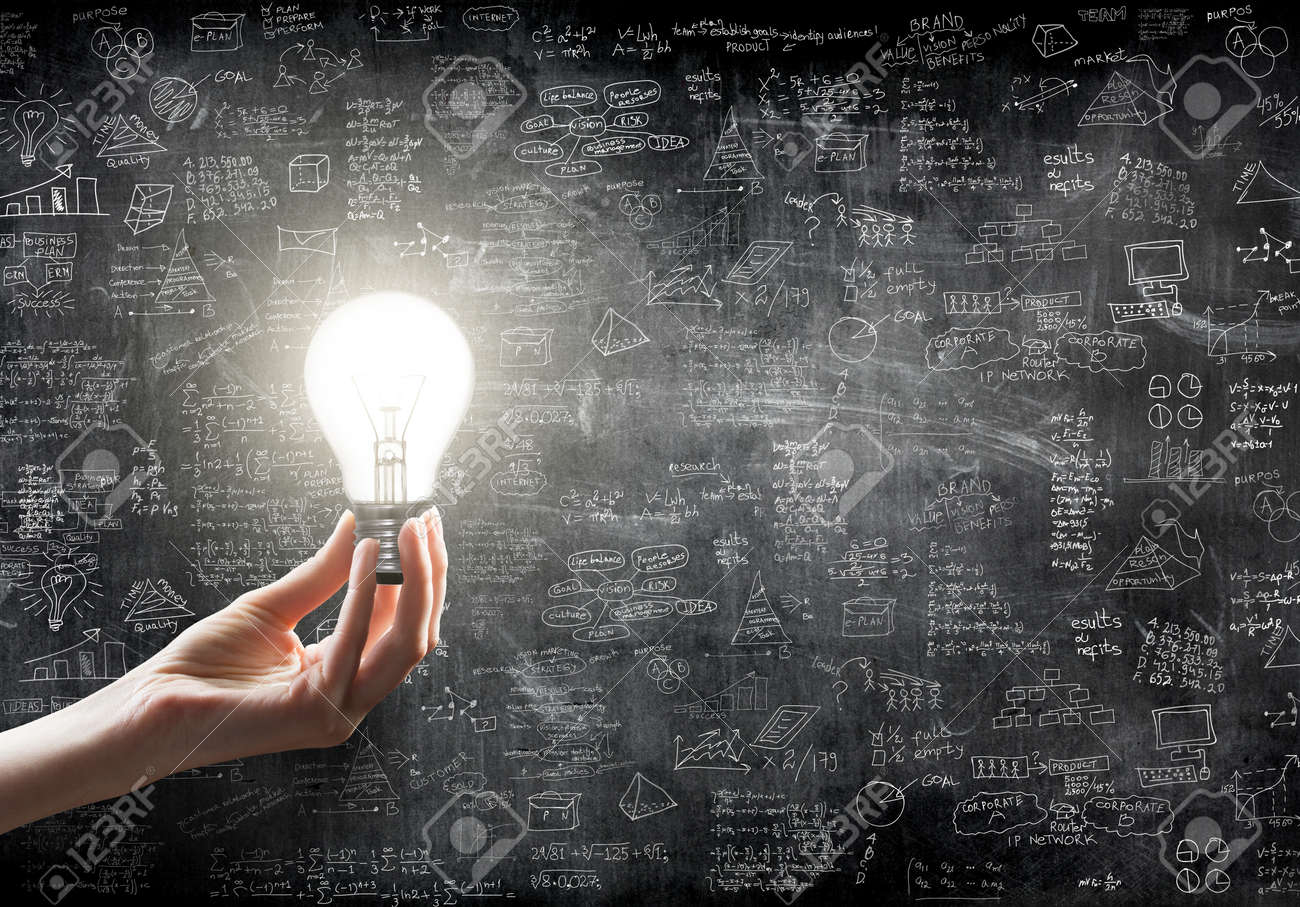 hand holding or showing a light bulb in front of business idea concept on wall backboard blackground - 41304923
