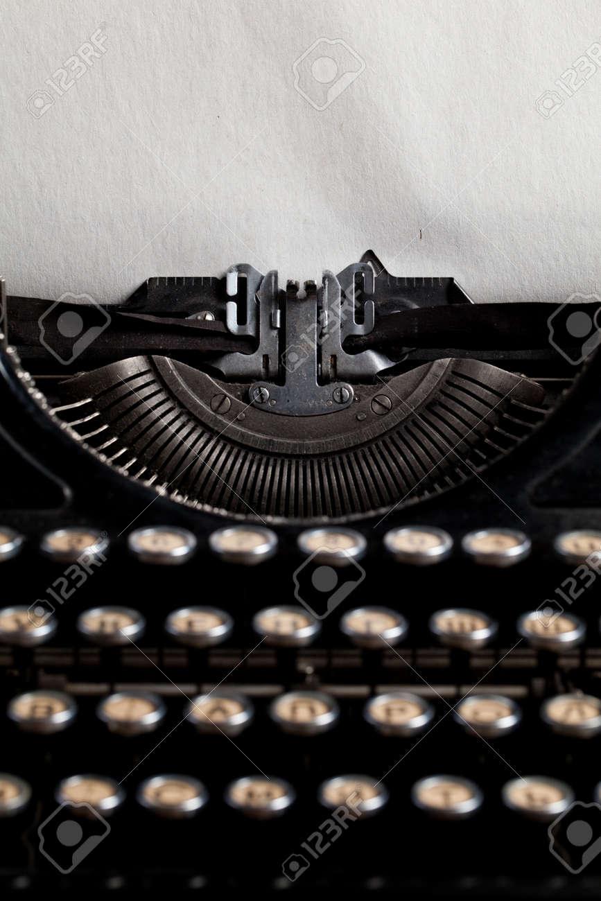 typewriter with aged textured paper sheet - 43847406