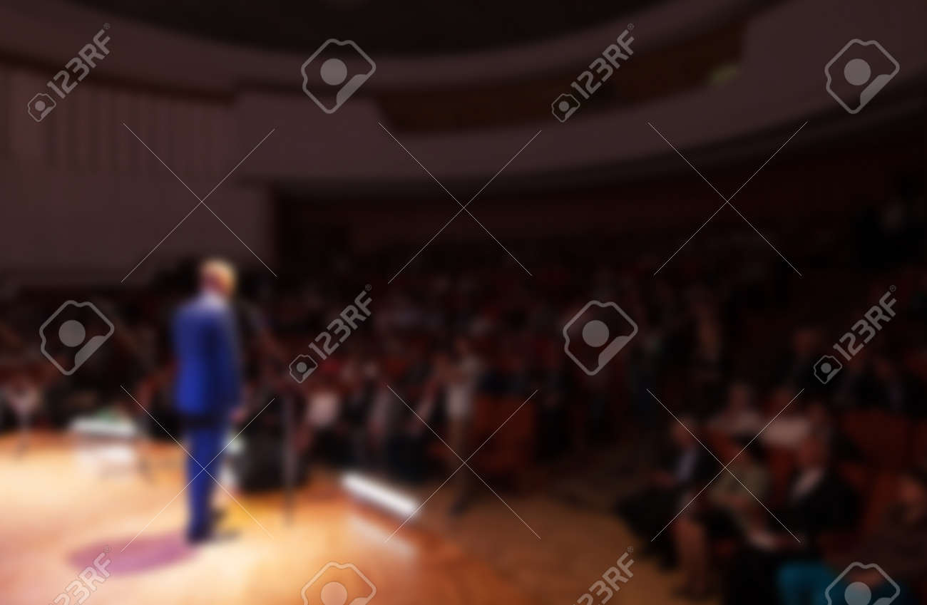 blurred image of a businessman giving a presentation in a conference/meeting - 47053377