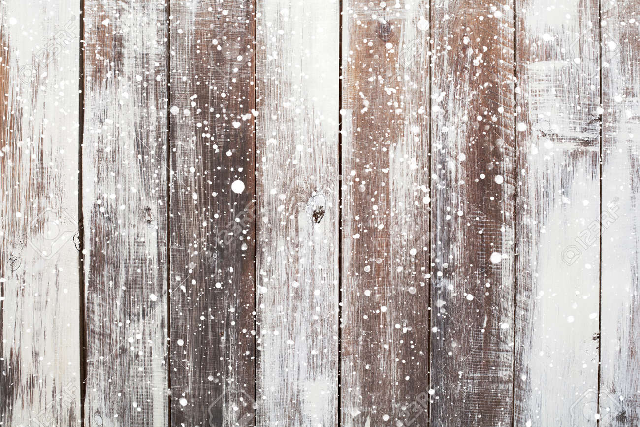 Christmas background with falling snow over wooden background - 47396385