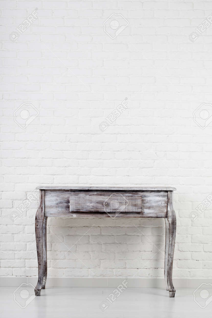 Empty wooden table over white brick wall - 47911512