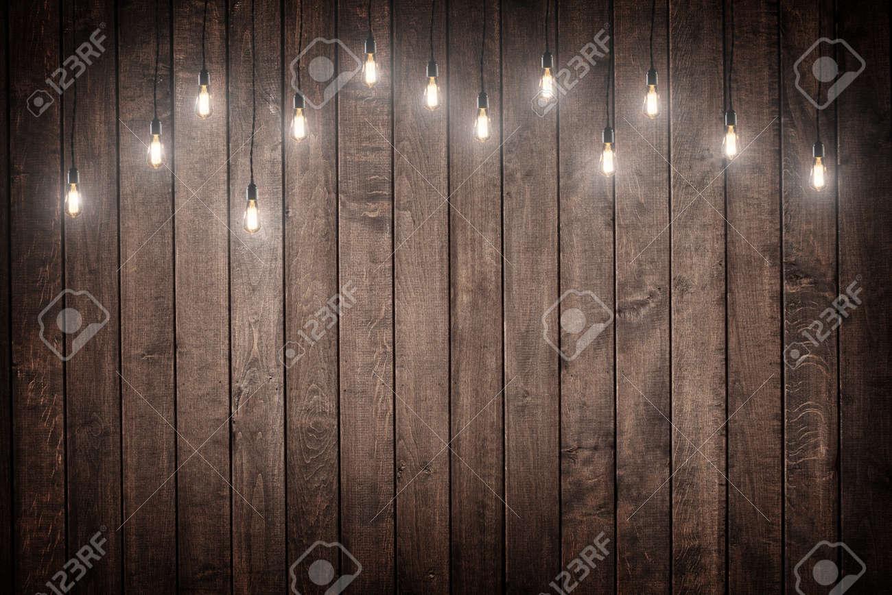 Light bulbs on dark Wooden Background - 48718802