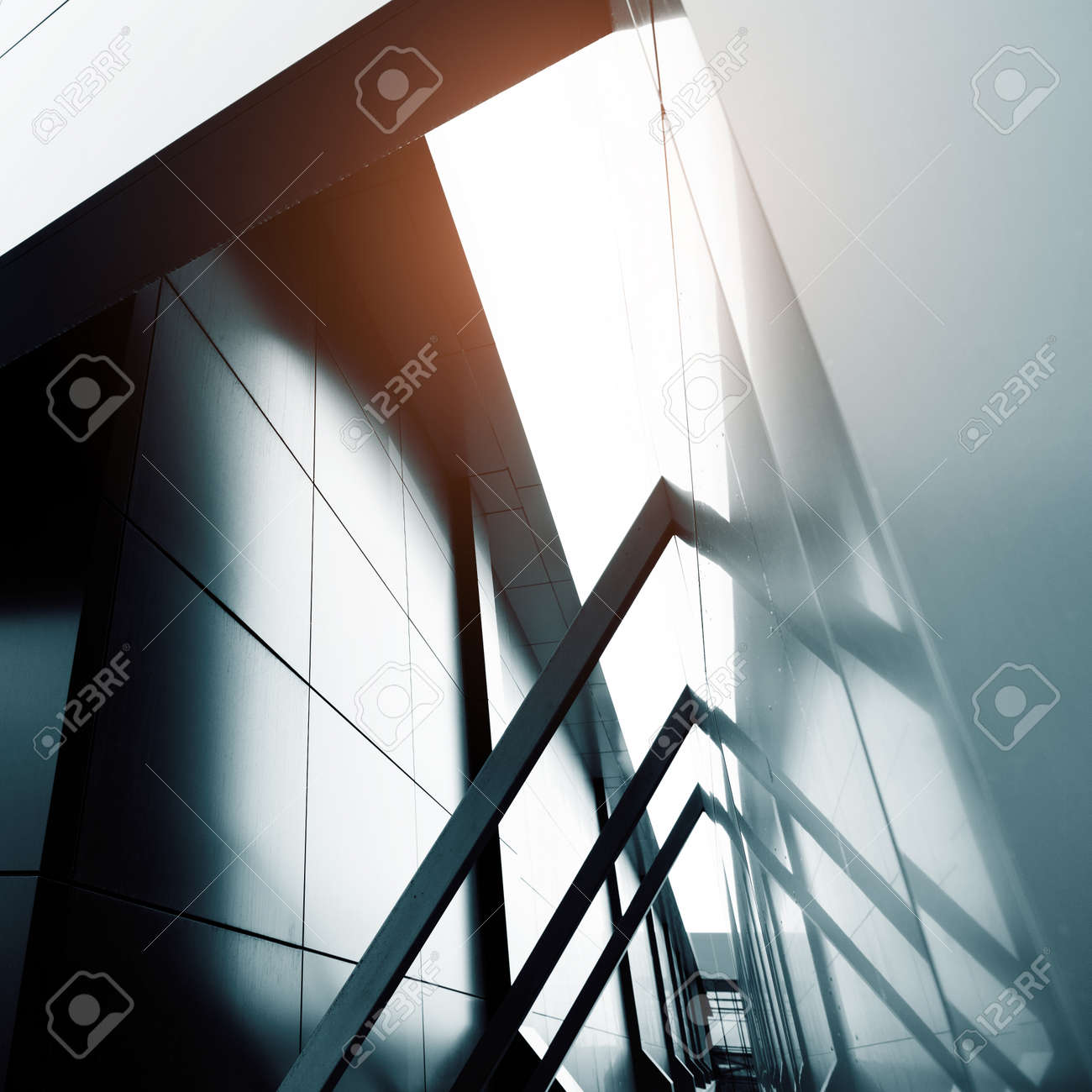 Wide angle abstract background view of steel light blue high rise commercial building skyscraper made of glass exterior. concept of successful industrial architecture and office center building - 56812556