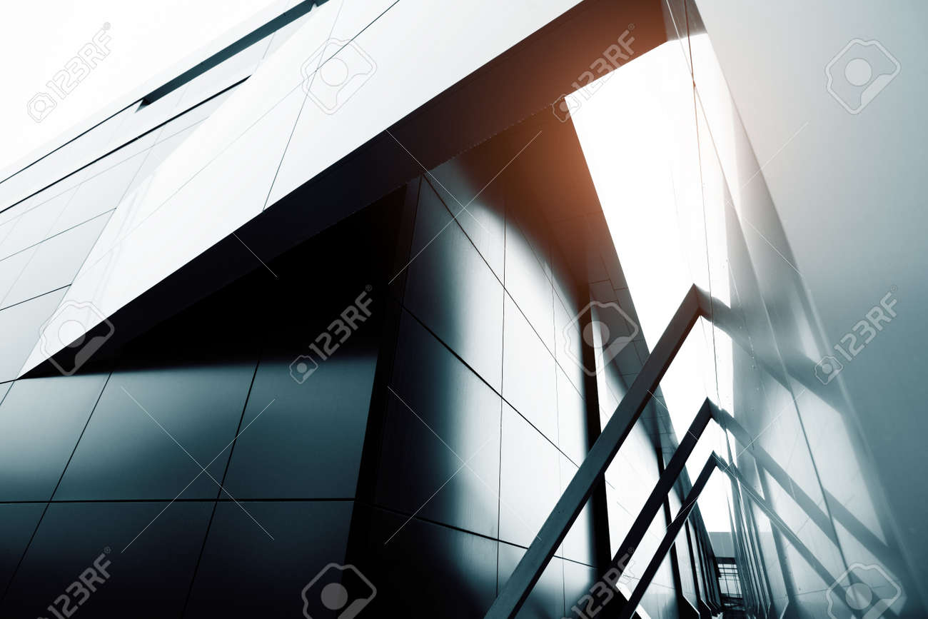 Wide angle abstract background view of steel light blue high rise commercial building skyscraper made of glass exterior. concept of successful industrial architecture and office center building - 56812573