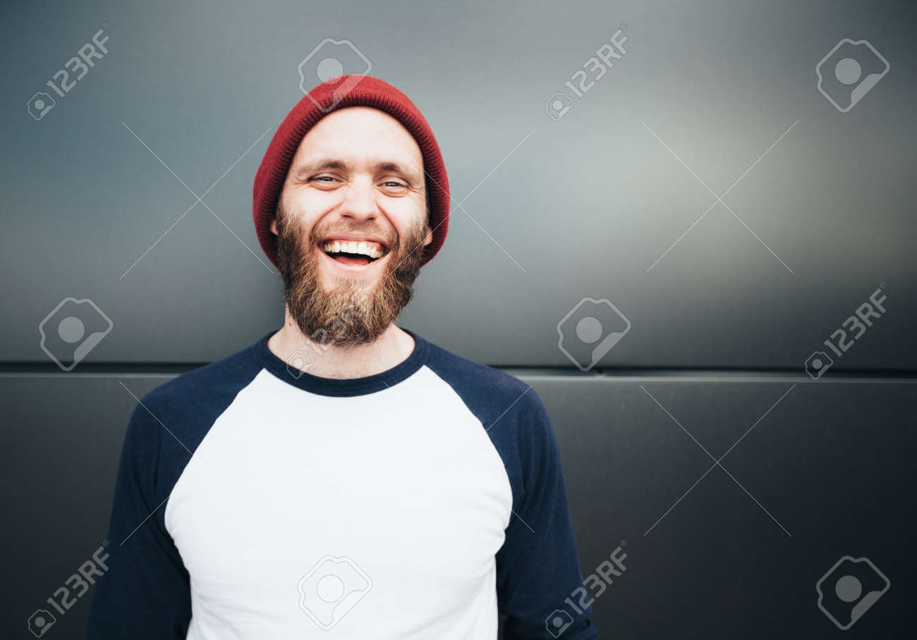 Hipster man smiling and wearing white blank t-shirt - 59952263