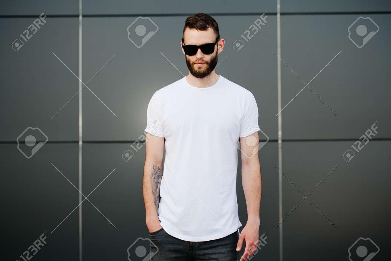 6f95ae47daa7 Hipster wearing white blank t-shirt with space for your logo Stock Photo -  59952436