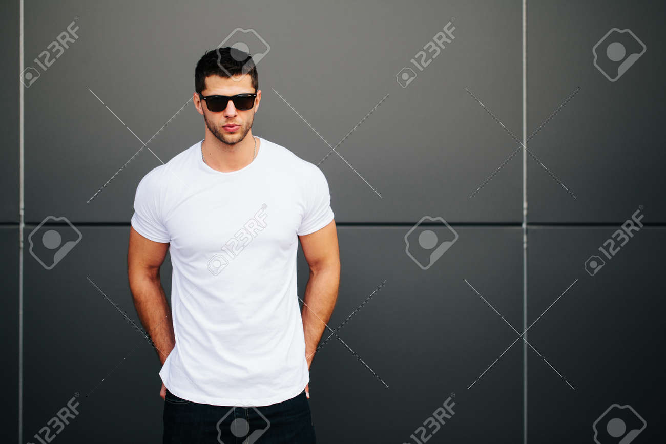 Man wearing white blank t-shirt with space for your logo - 62107055