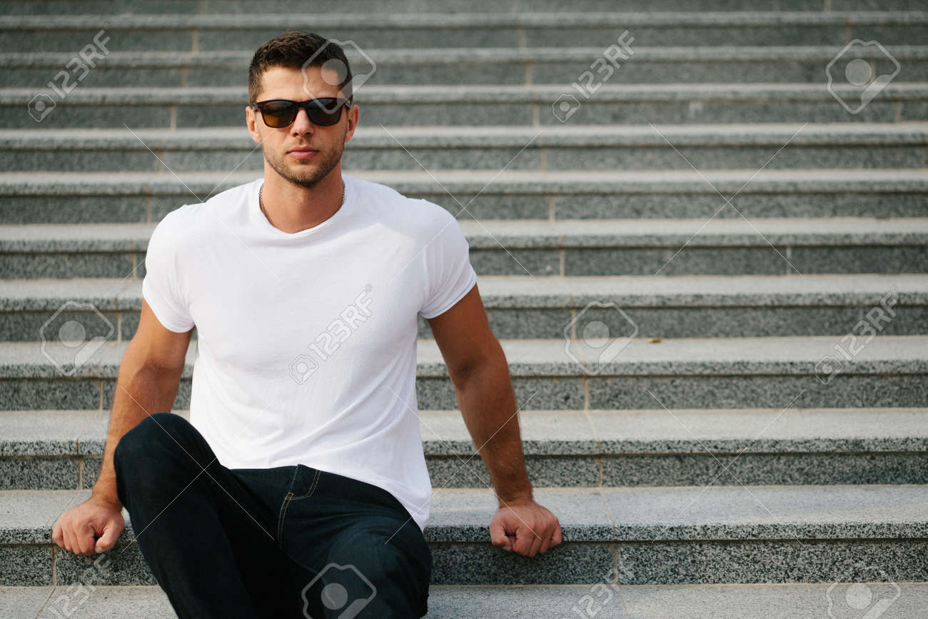 Man wearing white blank t-shirt with space for your logo - 72059355