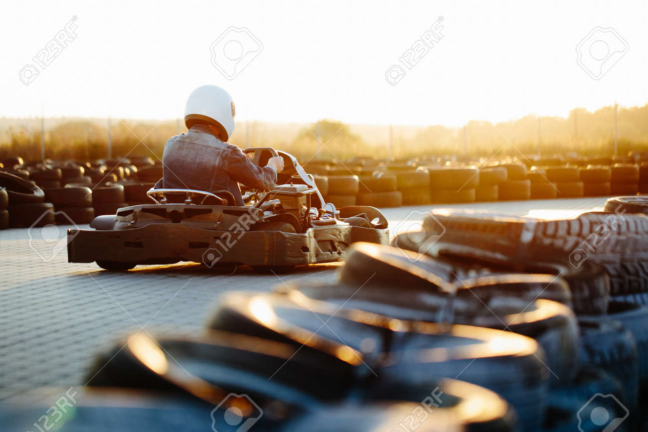 Karting competition or racing cars riding for victory on a racetrack - 85282784