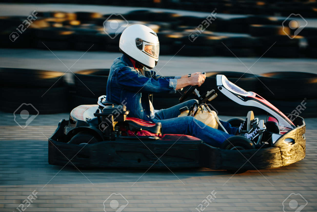 Karting competition or racing cars riding for victory on a racetrack - 85282834