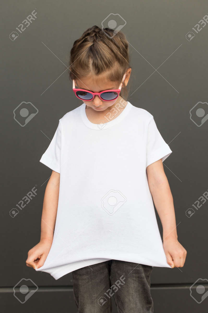 Girl kid wearing white blank t-shirt with space for your logo or design in casual urban style - 87475938