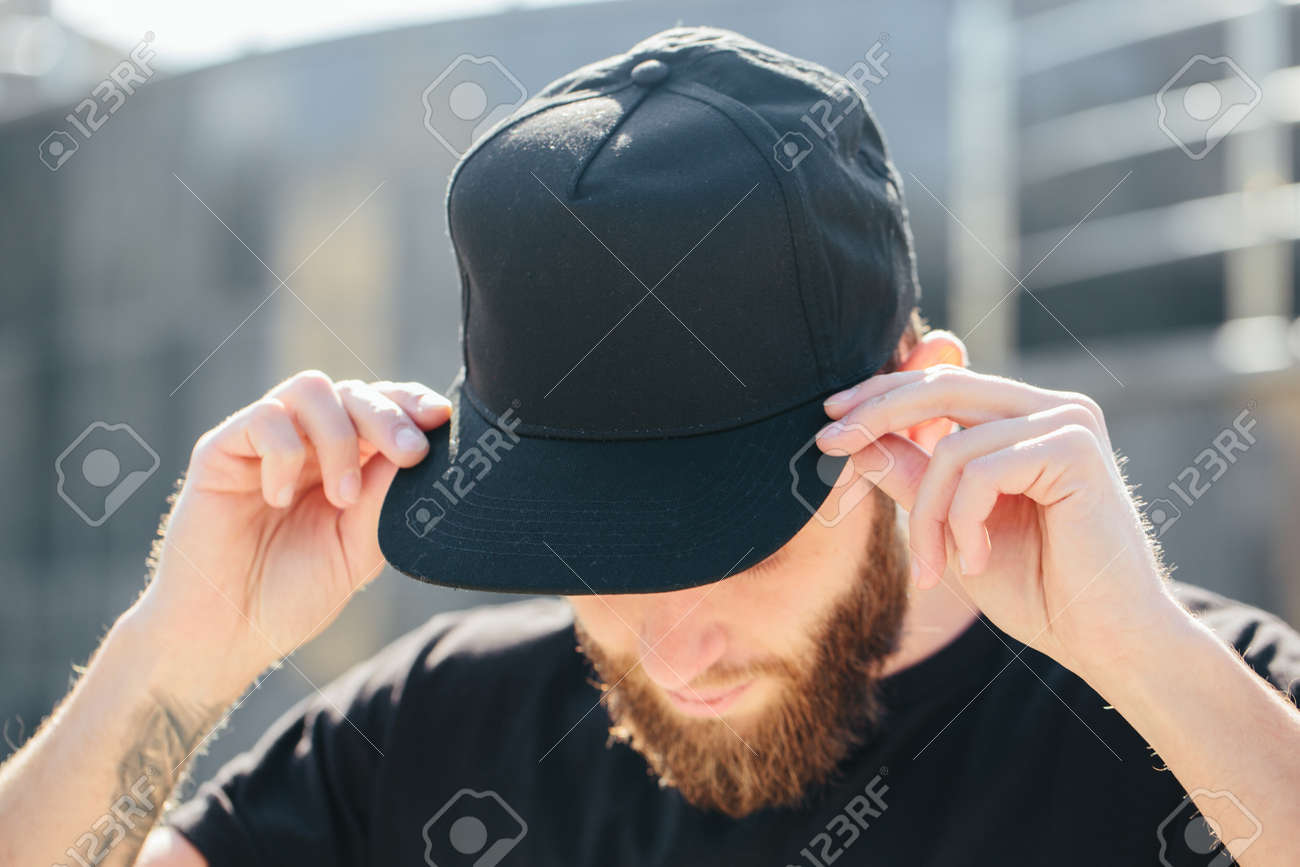 Hipster handsome male model with beard wearing black blank baseball cap with space for your logo - 87436205