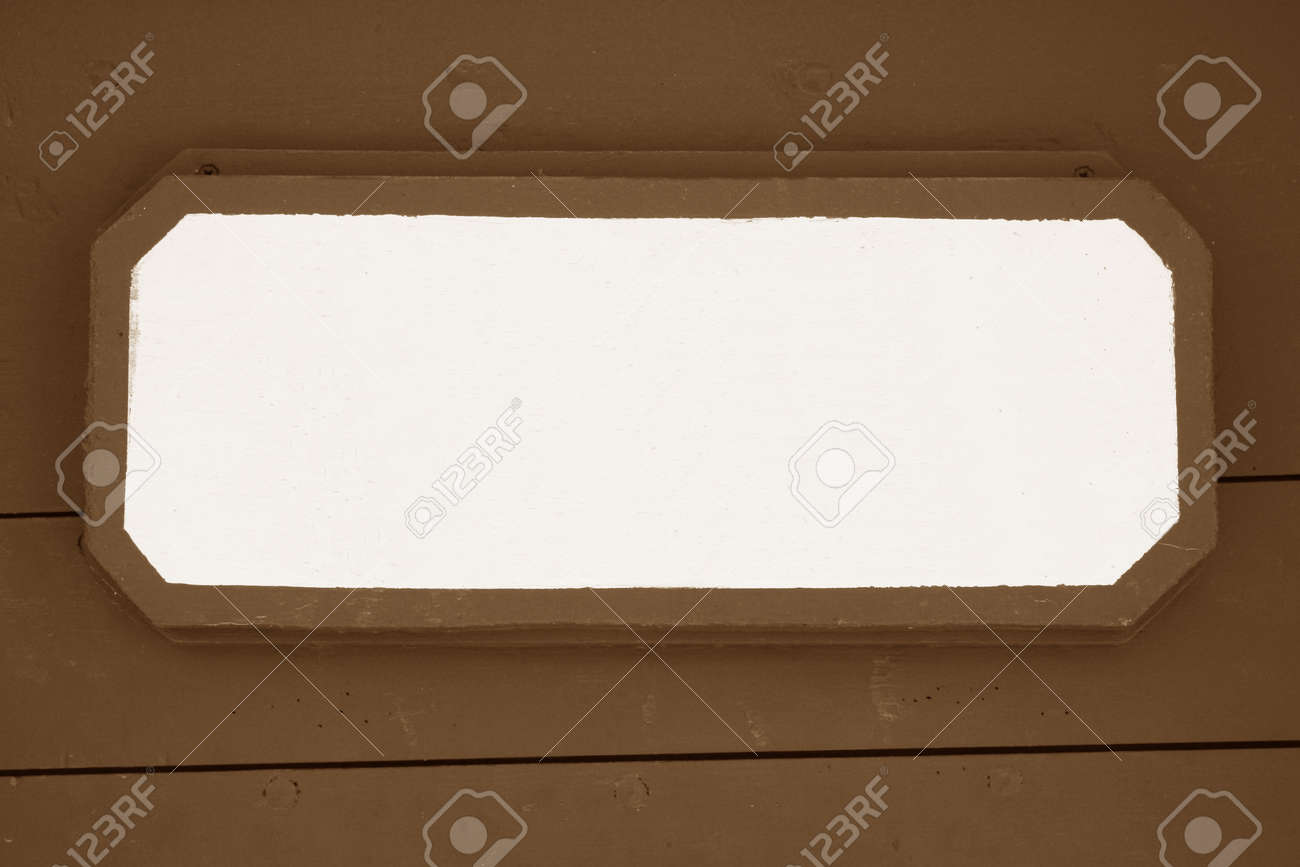 Wooden signboard on brown planks background Stock Photo - 22164342