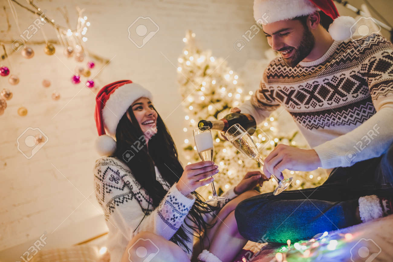 merry christmas and happy new year attractive young couple is celebrating holiday at home together