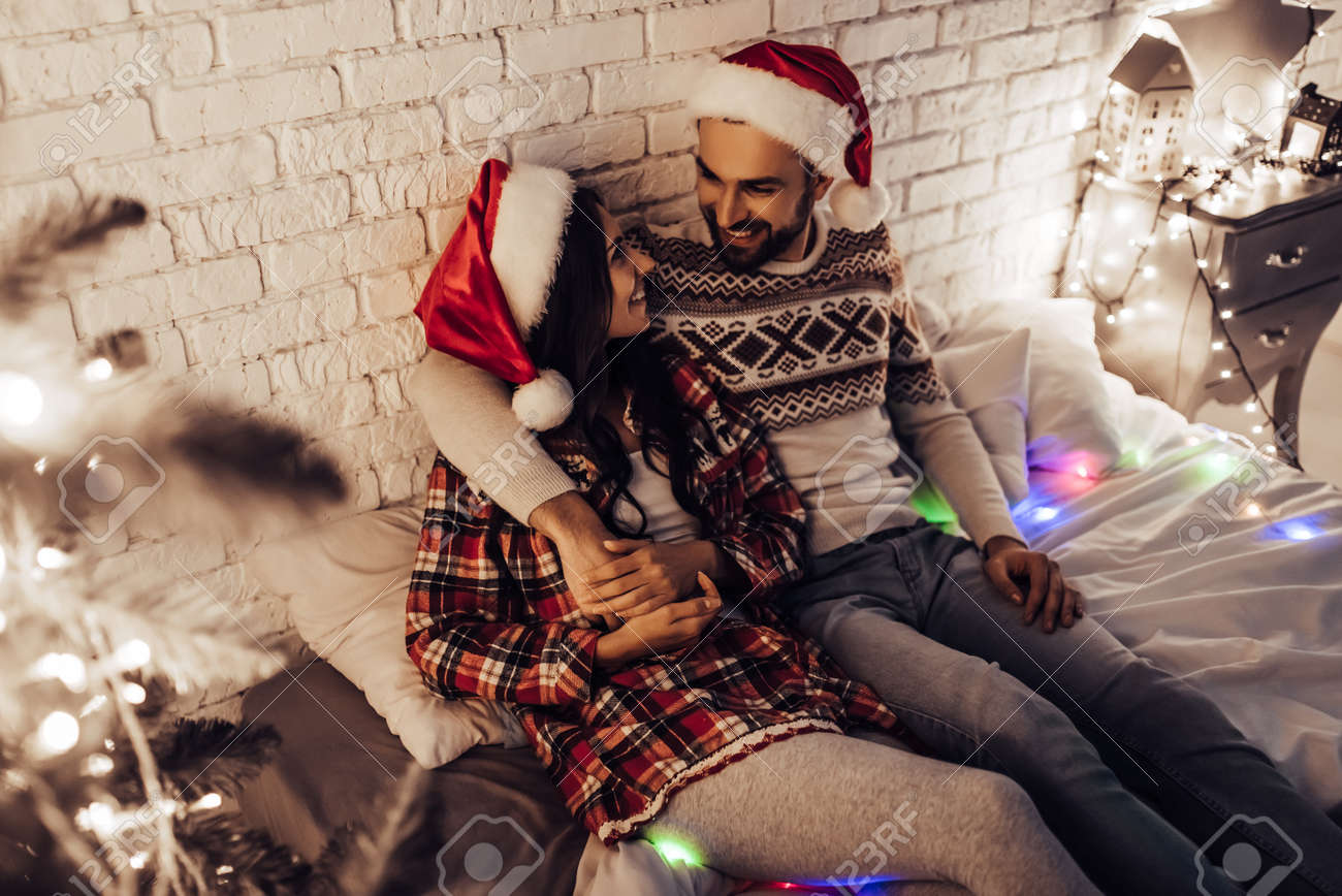 Merry Christmas And Happy New Year Beautiful Couple Is Lying Stock Photo Picture And Royalty Free Image Image 90776087