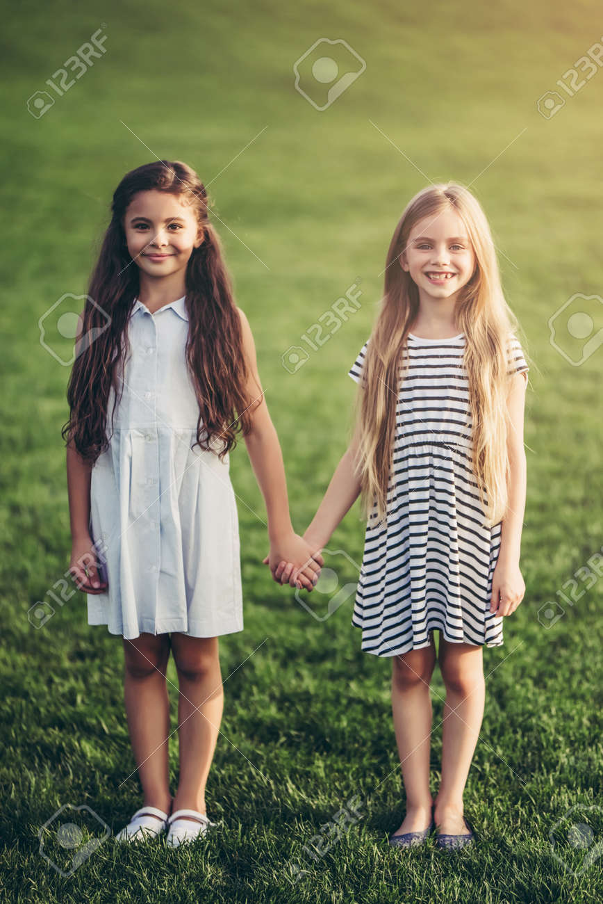 Little Pretty Girls Having Fun Outdoor Two Cute Girls Are