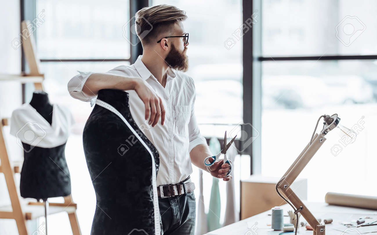 Handsome Male Fashion Designer Is Working In His Workshop Stylish Stock Photo Picture And Royalty Free Image Image 96131648