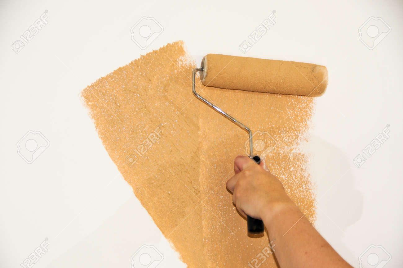 Female hand roller painting a white wall Stock Photo - 15395583