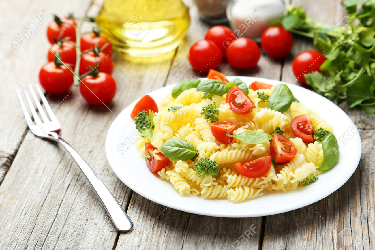 Delicious pasta on plate on grey wooden background - 41814738