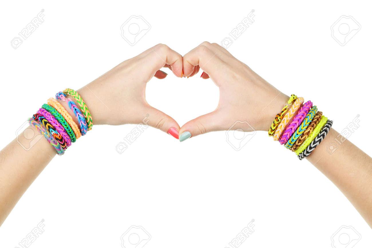 Manos Femeninas En Forma De Corazón Con Pulseras De Goma De Colores Fotos Retratos Imágenes Y Fotografía De Archivo Libres De Derecho Image 42194734