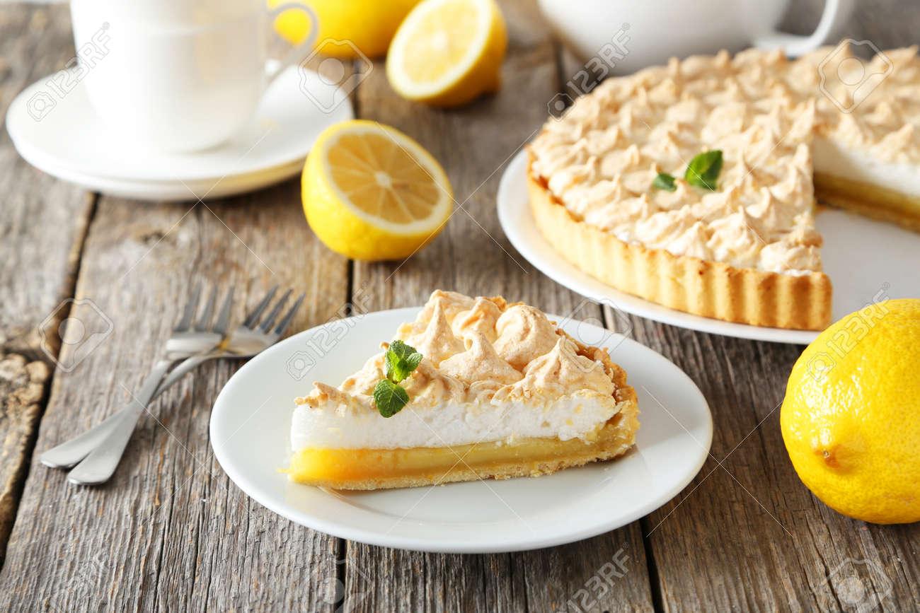 Lemon meringue pie on plate on grey wooden background - 42667288