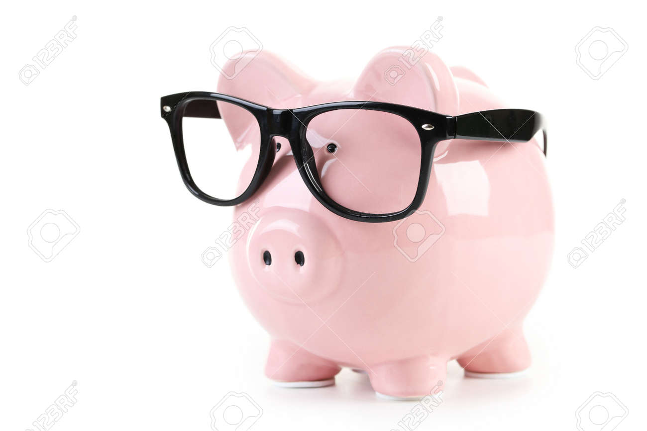 Pink piggy bank with glasses isolated on a white - 43016513