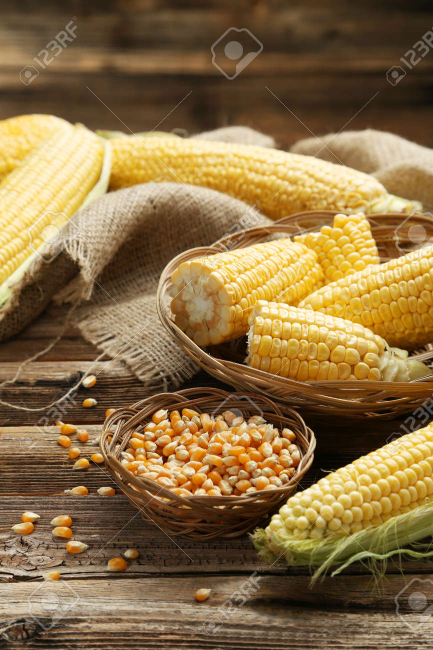 Corns in basket on a brown wooden background - 43016530