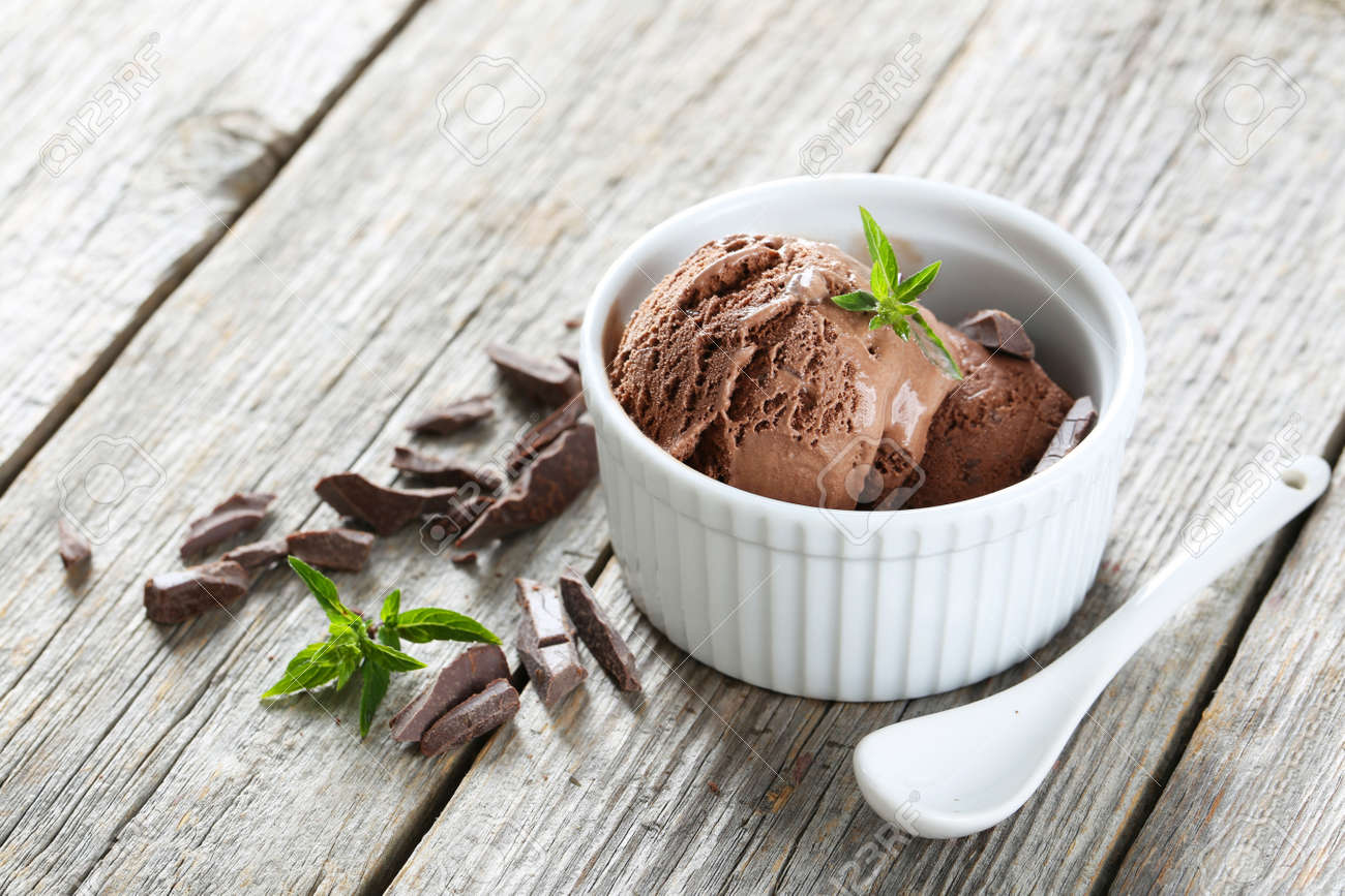 Sweet chocolate ice cream in bowl on grey wooden background - 43739181