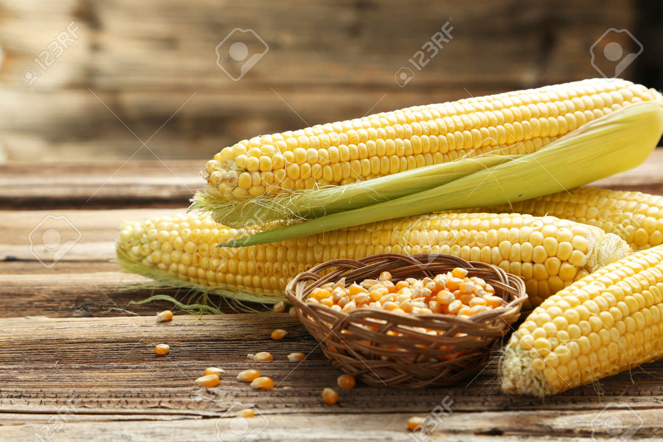 Corns on a brown wooden background - 44655888