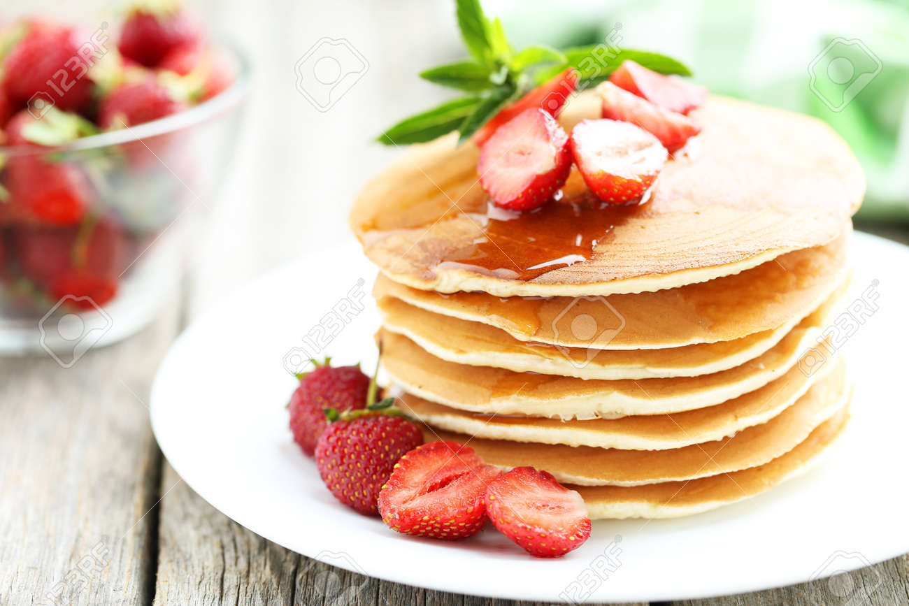 Tasty pancakes with strawberry on grey wooden background - 44845325