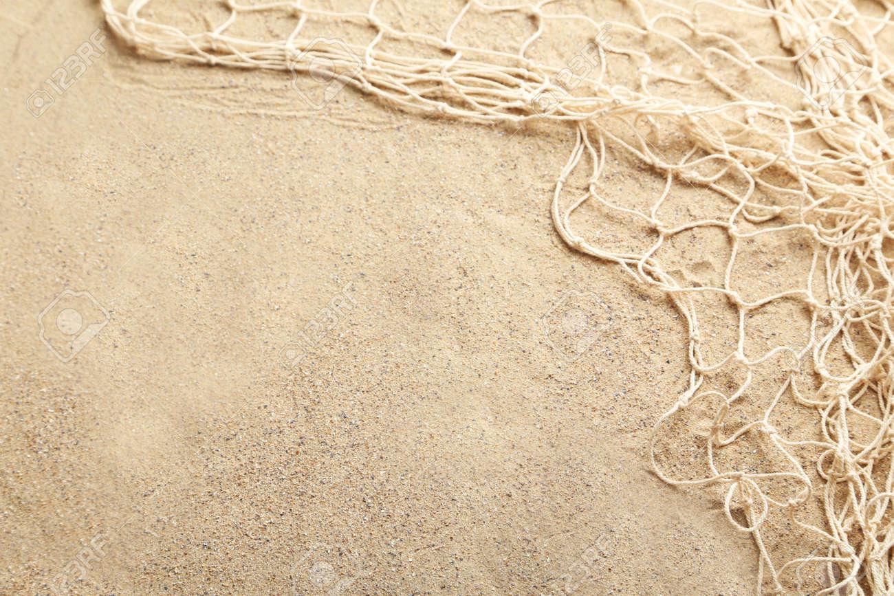 Fishing net on a beach sand - 44981470