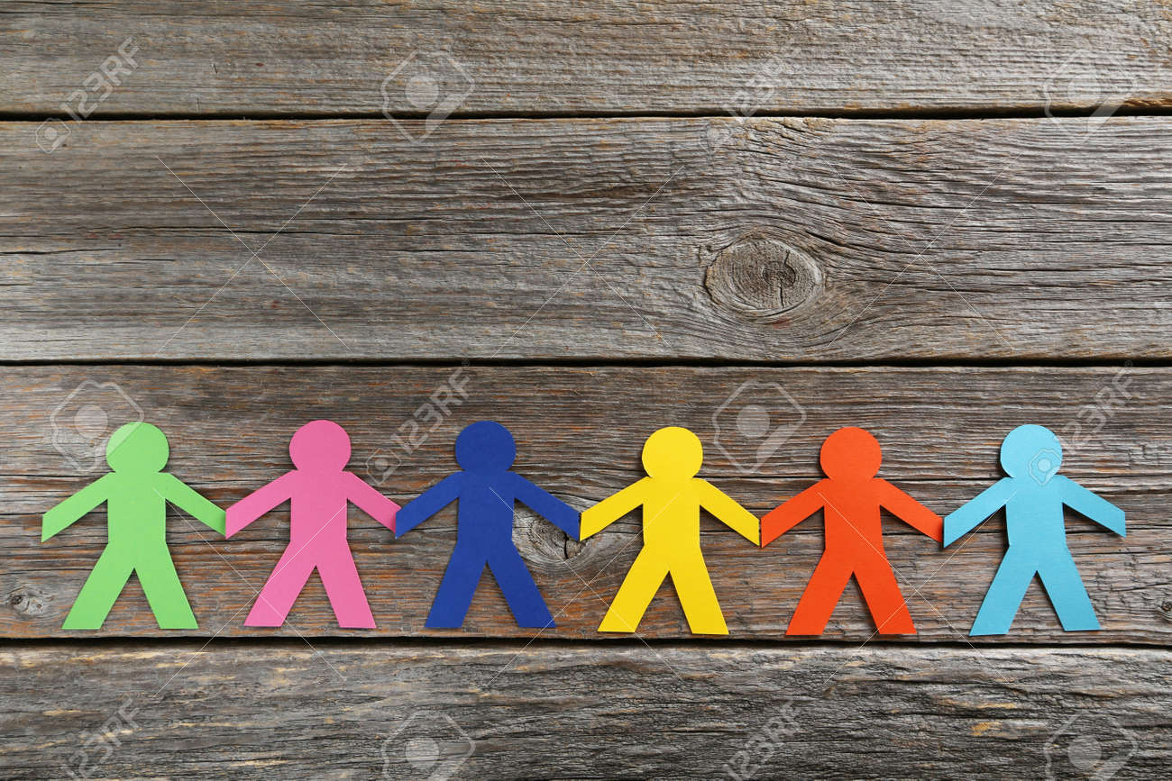 Paper people on the grey wooden background - 45501818