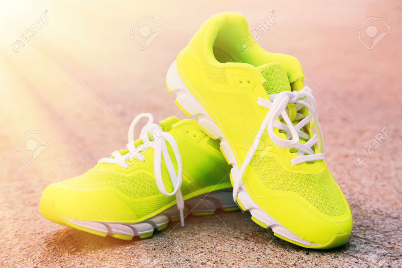 Pair of sport shoes outdoors. Toning - 46533802