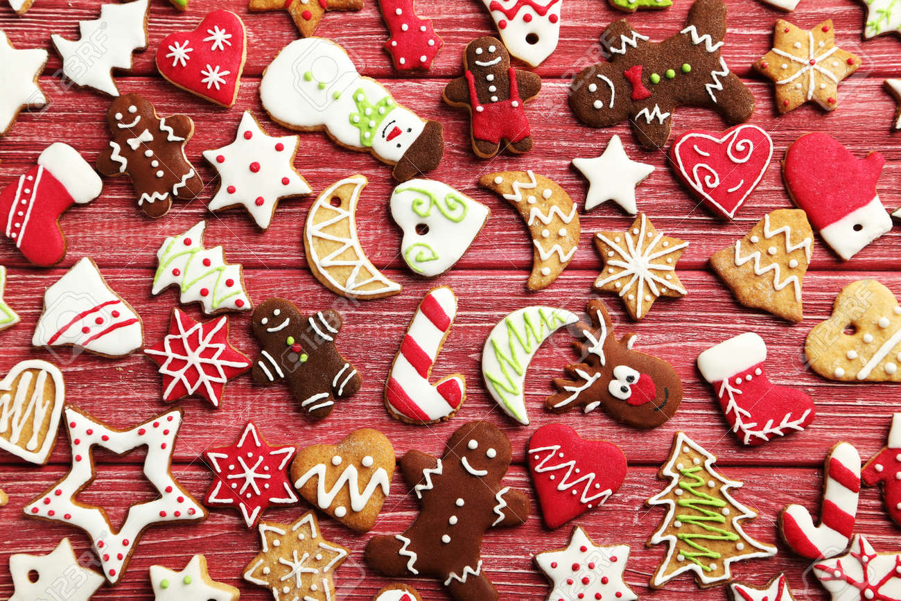 Christmas cookies on a red wooden table - 48771931